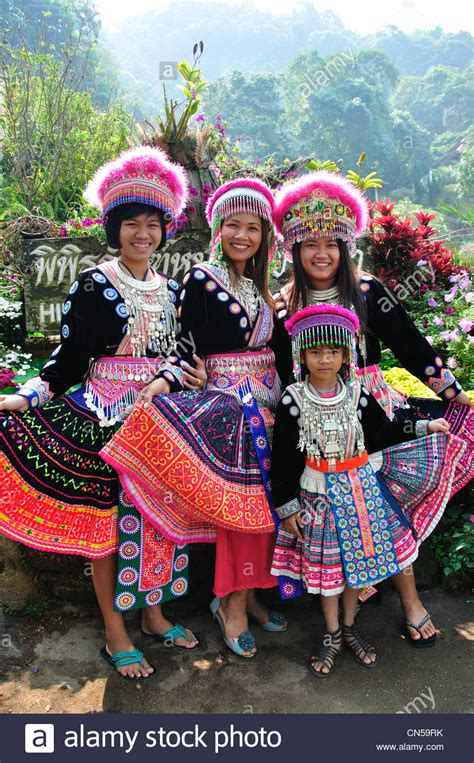 Akha Hill Tribe Group In Traditional Dress At Village