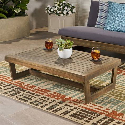 Get free shipping on qualified round outdoor coffee tables or buy online pick up in store today in the outdoors department. Hannah Outdoor Acacia Wood Coffee Table - GDF Studio
