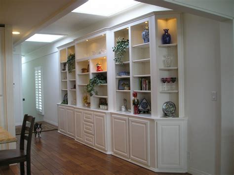 custom white wall unit with bookshelves a customer favorite in southern entertainment centers designed built installed