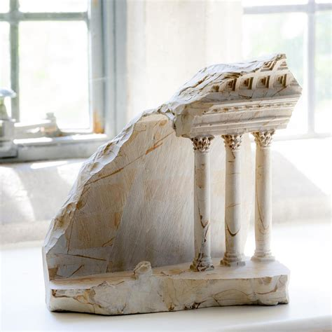 miniature interiors carved into marble blocks