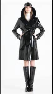 black raincoat amp white turtleneck it s raining it s