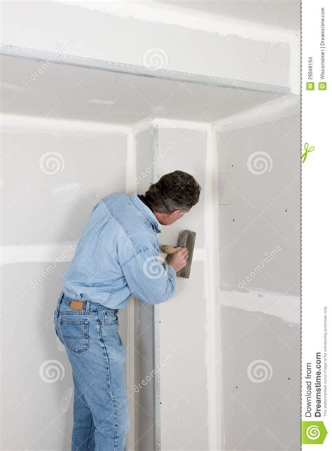 home improvement contractor man install drywall stock