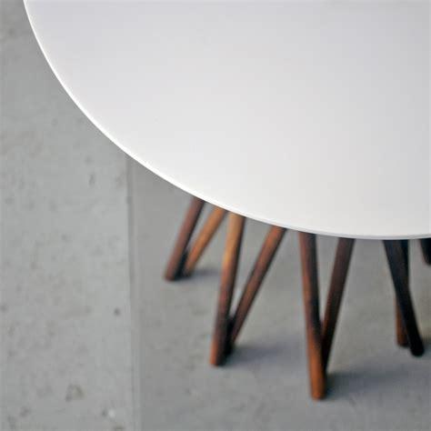 black corian bundle side table white corian black walnut