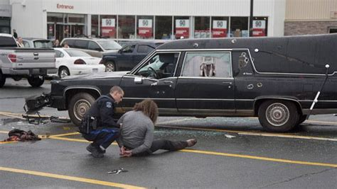 man attacks junker hearse  canadian tire parking lot