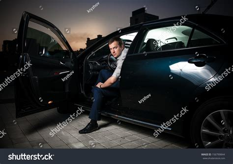 Sexy Man Sitting In Car With Front Door Open Stock Photo