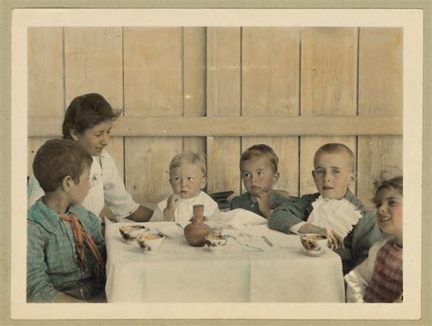 vintage picture  children sitting    table
