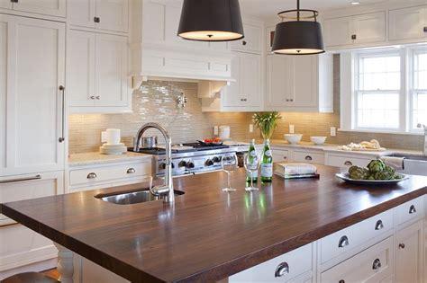 white kitchen island  dark wood countertop