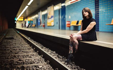 subway train station women tattoo brunette sitting black