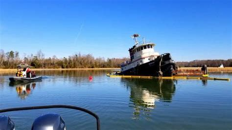 official partially submerged tugboat spills oil