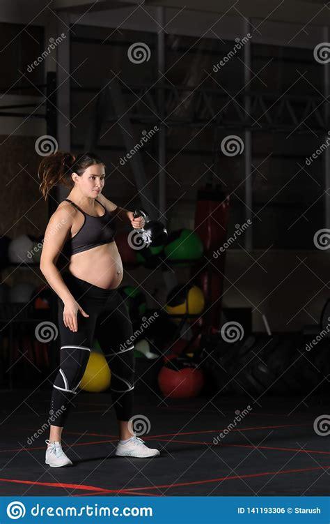 athlete kettlebell swing pregnant doing workout female