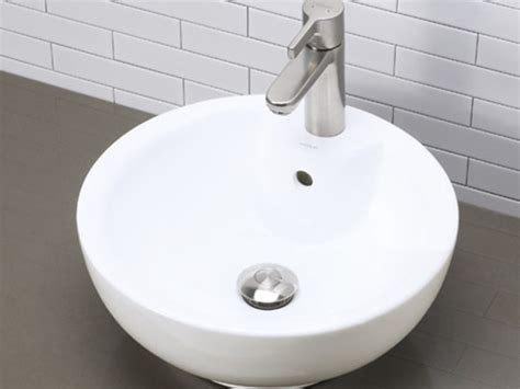 Decolav Round White Vitreous China Vessel With Faucet Hole
