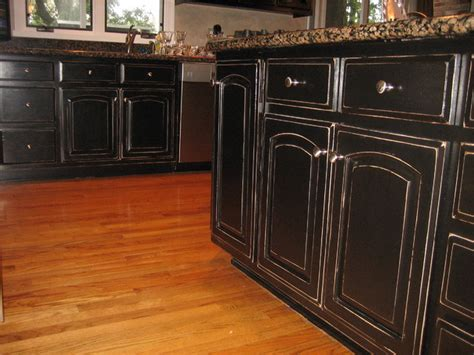 Handpained And Distressed Black Kitchen Cabinetry