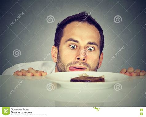 Hungry Man Craving Sweet Food Stock Photo