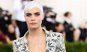Cara Delevingne is tired of society's beauty standards