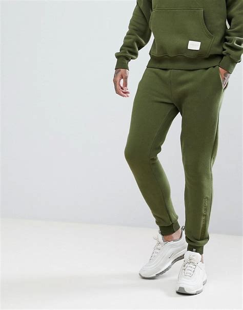 criminal damage logo joggers in khaki green criminaldamage cloth brondong