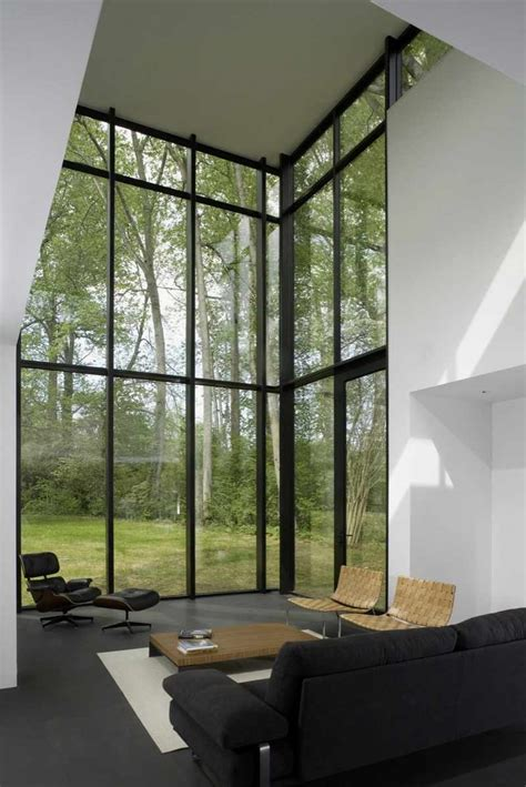 Black And White House With Modern Glass Building