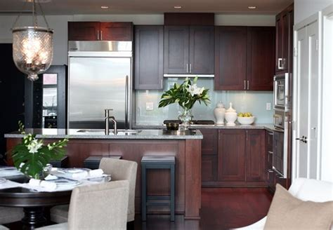 Cherry Kitchen Cabinets With Grey Walls.