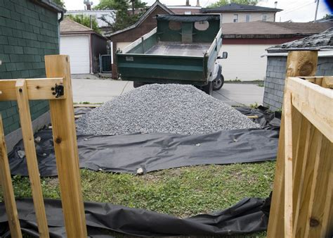 Gravel Yard by One Canadian Home Creating A Gravel Parking Pad