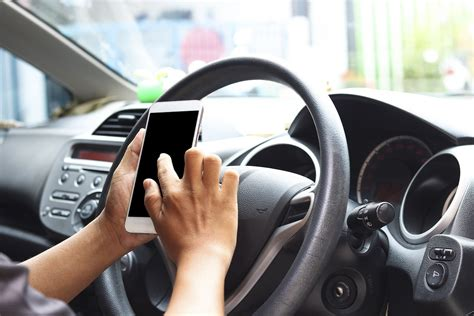 mobile phone  driving  unacceptable