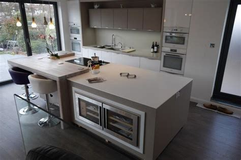 kitchen island worktop mix of corian and spekva wood designed by moore by design and fabricated by counter production