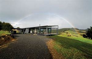 Truss Style New Zealand Glass House With Complex Interior