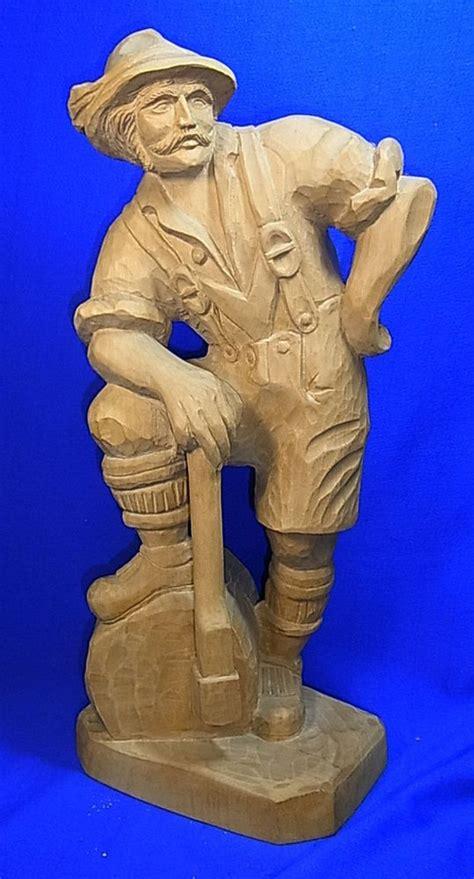 vintage german wood carved statue figure lumberjack