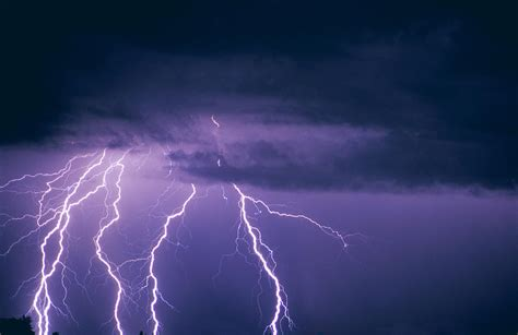 Lightning And Thunderclouds Photograph by Carson Ganci