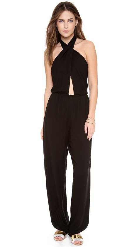 cross jumpsuit indah pearl cross front halter jumpsuit in black lyst