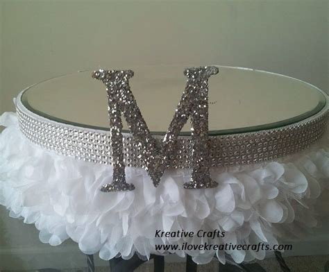 wedding cakes stand white adorned with and silk monogrammed quot m quot with mirror top