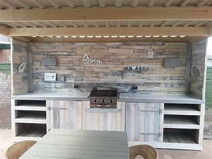 outdoor kitchen made of old pallets pallets pinterest With kitchen cabinets lowes with large pallet wall art