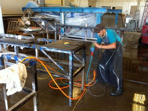 polishing a granite slab in our manufacturing facility