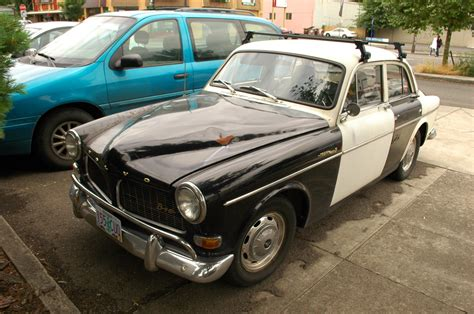 parked cars  volvo amazon