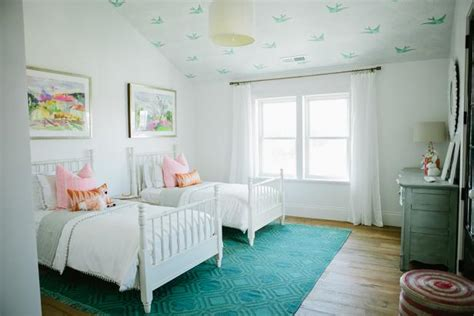 Decorating Ideas For A 2 Bedroom House by Bright White Farmhouse S Bedroom With Bird Ceiling