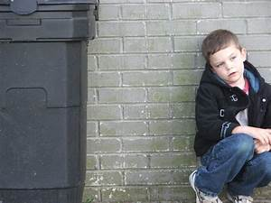 Garbage Can Kid stock photo. Image of cower, lonely, trash ...
