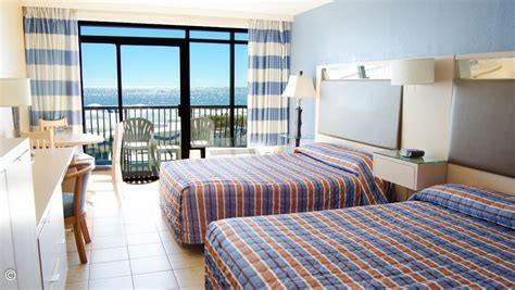 2 Bedroom Hotel Suites Myrtle Beach Sc Living Room Ideas On A Low Budget Design Grey Carpet Blue Sofa Decor Feng Shui Rooms With Tv In Corner Beach Themed Chairs Ultra Modern Interior Dulux Colour Schemes For