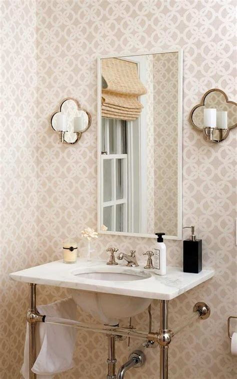 powder room  wallpaper  mirrored wall sconces