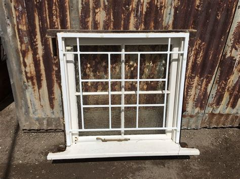 timber casement window  textured glass  security bars