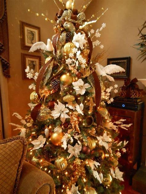 christmas tree filled  white poinsettias gold