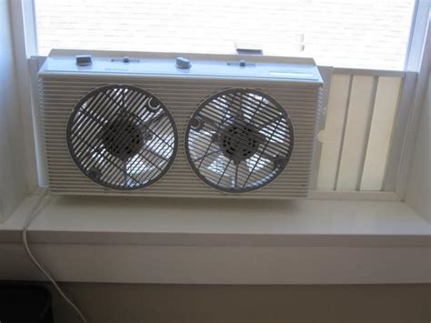 holmes twin window fan with comfort control thermostat holmes twin window fan with manual thermostat oak bay