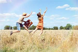 Joyful Young Couple Having Fun In Wheat Field. Excited Man ...