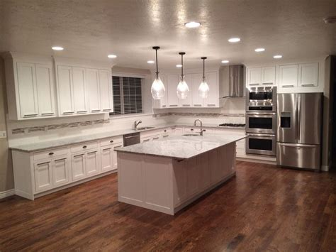 white cabinets hardwood floors look at those floors