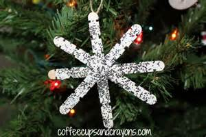 craft snowflake ornaments coffee cups and crayons