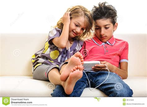 to play with friends the phone children on cell phone stock image