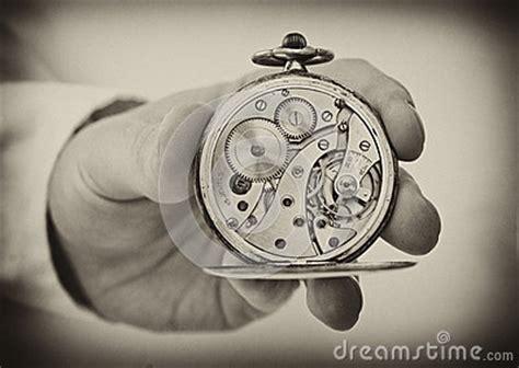 hand holding antique pocket  show  clockwork