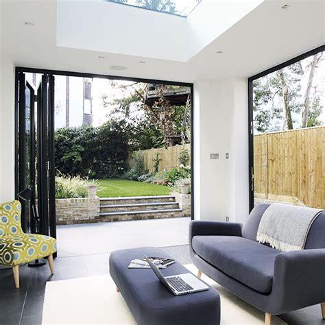 Modern living room with bi fold doors   Decorating   Ideal