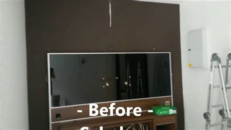 120 inch projector screen in front of TV cabinet