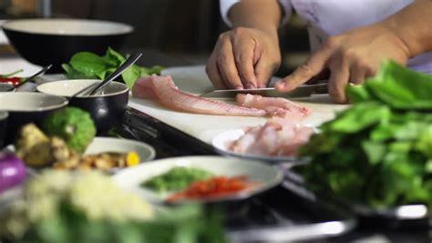 cuisine and cook up of chef cooking and preparing food and sushi in restaurant kitchen rack