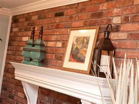 brick wall  traditional white mantel  accessories