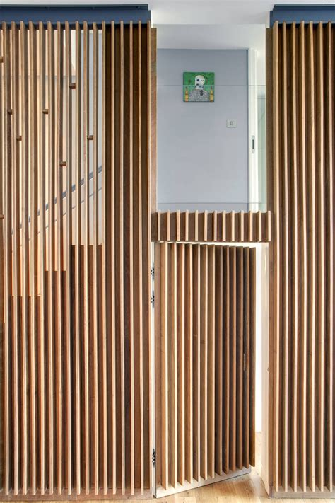 at the door wood slats add texture and warmth to these homes