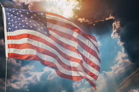 american flag flying  beautiful sunset sunrise